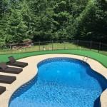 inground pool with putting green