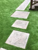 Pavers cut into synthetic grass . Brookline MA