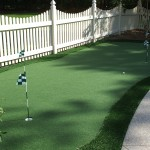 white picket fence and putting green