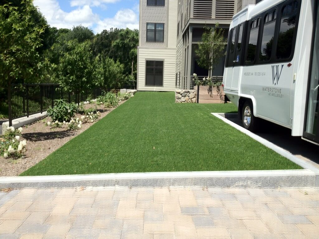 truck parked near synthetic turf