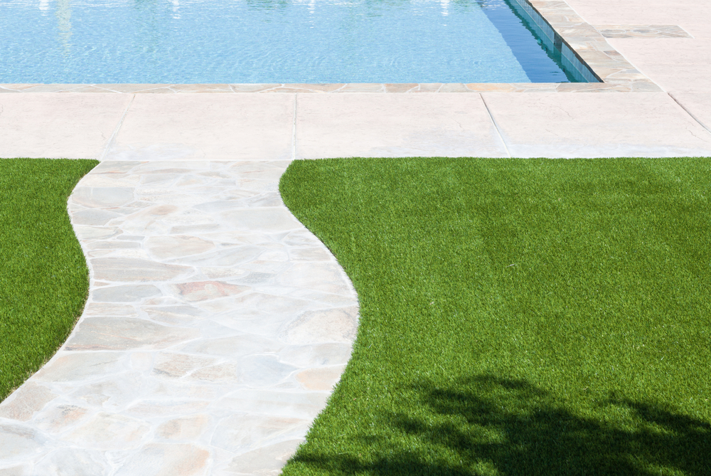 synthetic turf next to a pool
